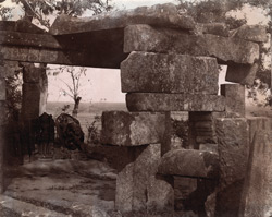 Close view of portion of ruined temple, with sculptured slabs in background, Mandaur, Gaya District